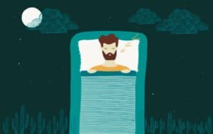 A guy in deep sleep on his bed at night